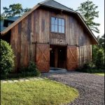 Rustic Barndominium With Gambrel Roof And Gravel Front