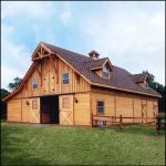 Traditional Wood Barndominium With Dormers